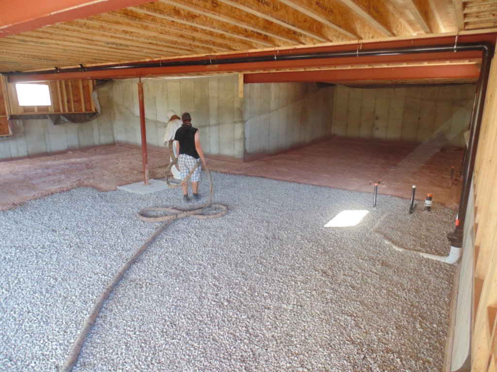 Workers Apply Spray Foam Under the Basement Floor